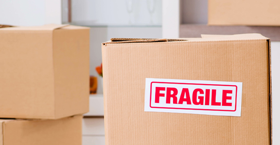 fragile handle with care label on white background labeling products that are fragile with colored paper