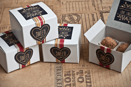 white packaging boxes with red and gold accents for packing cookies