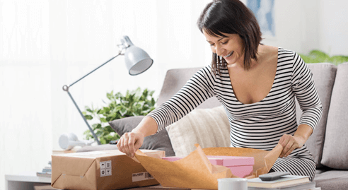 woman packing boxes for delivery
