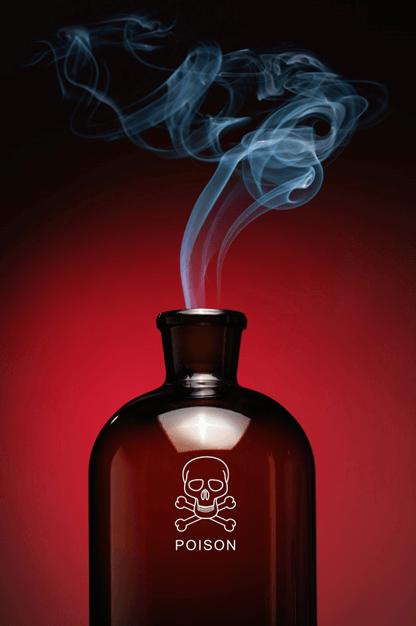 A TOXIC HAZARD sign on a bottle