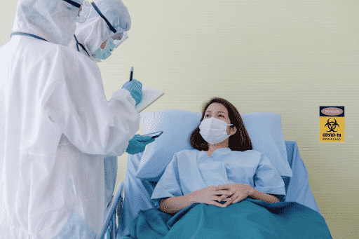 Medical workers interviewing a COVID-19 patient