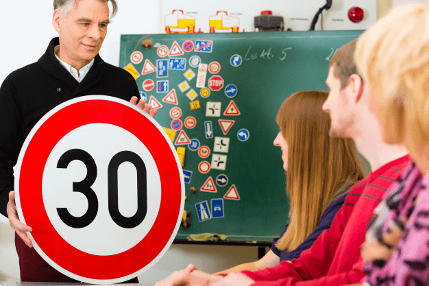 People studying road signs