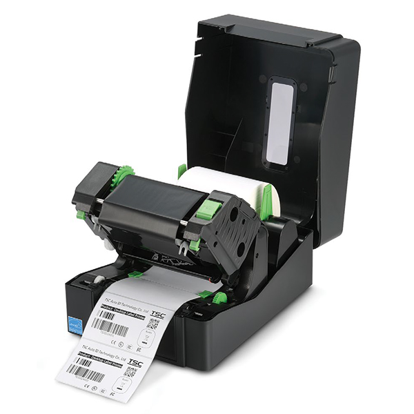 A label roll and thermal ribbon are properly placed inside a TSC printer