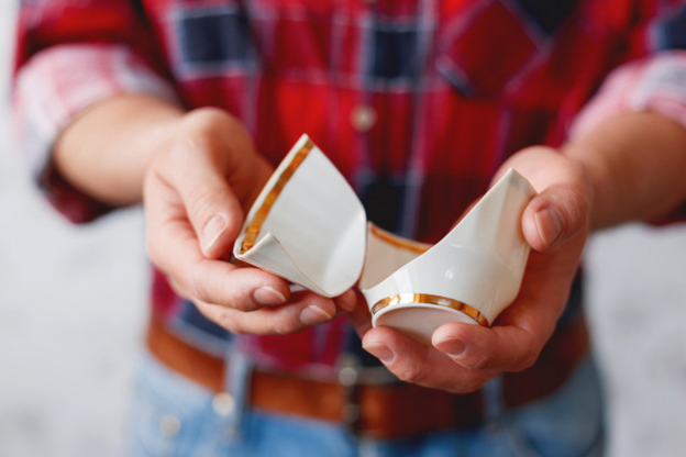 A broken cup received through the mail