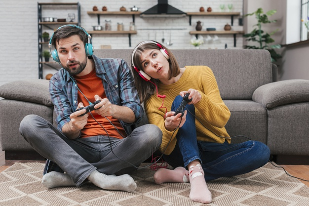A couple happily playing a video game
