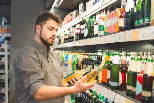 A customer is looking at beer labels