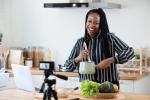 An African-American food maker vlogging on her website