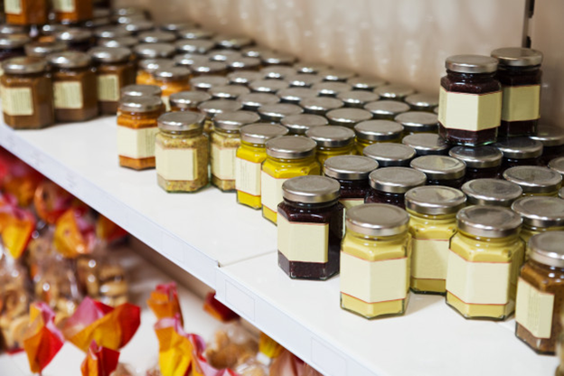 Jars with blank labels are displayed on a shelf