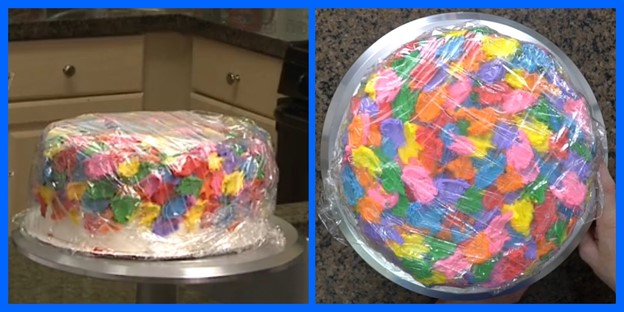 A plastic-wrapped frozen funfetti buttercream cake