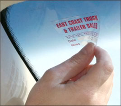 This oil change sticker is an example of a clear BOPP label