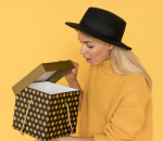 A woman opening a box