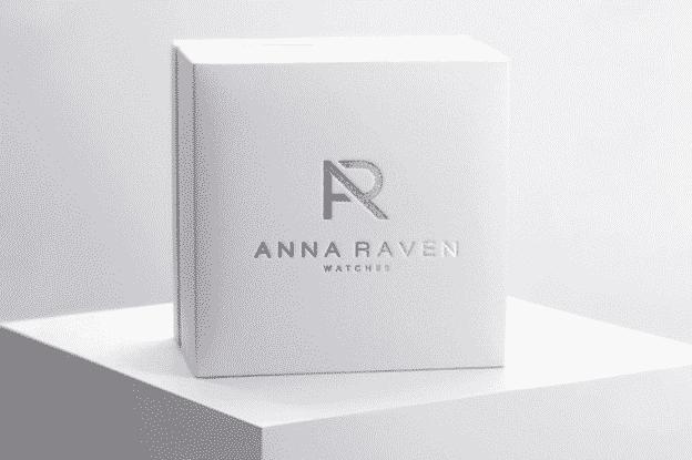A white box with a metallized logo