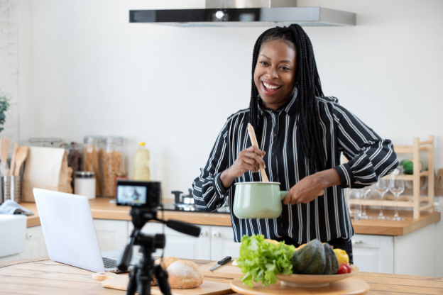 An African-American food maker vlogging on her website