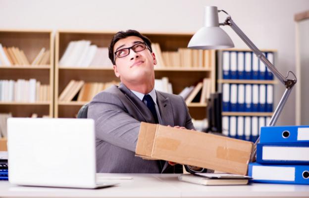 An unscrupulous office employee stealing from inside a package