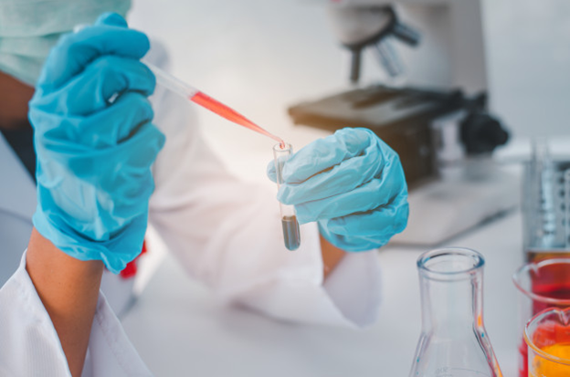 A researcher mixing chemicals in the lab