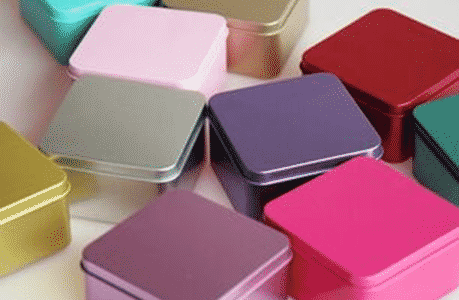 Colored tin candy boxes and canisters