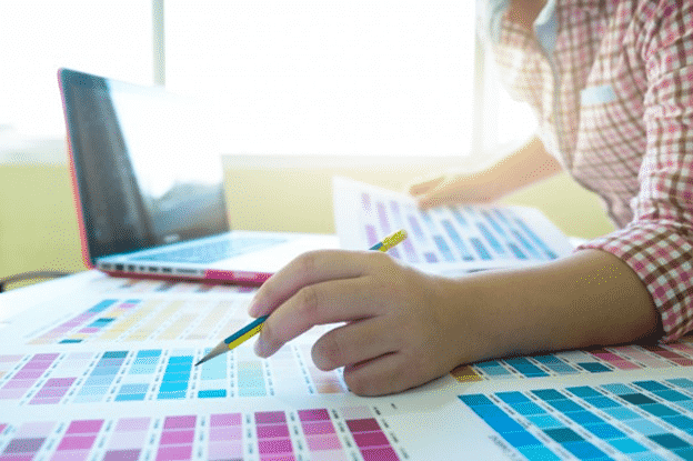 A graphic designer working with Pantone colors