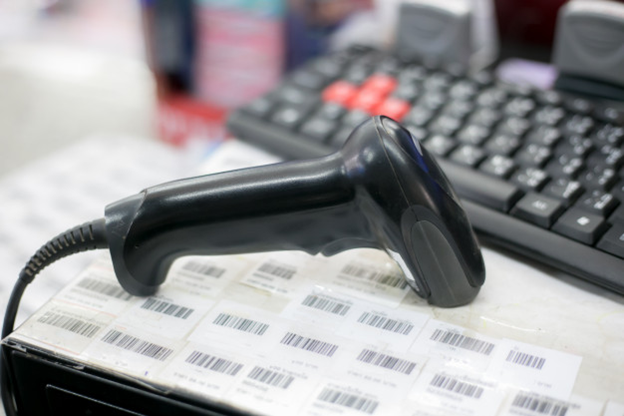 A scanner on top of some printed barcodes
