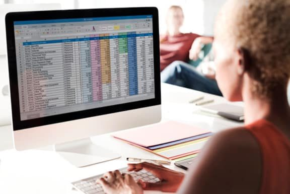 Woman-arranging-data-in-excel