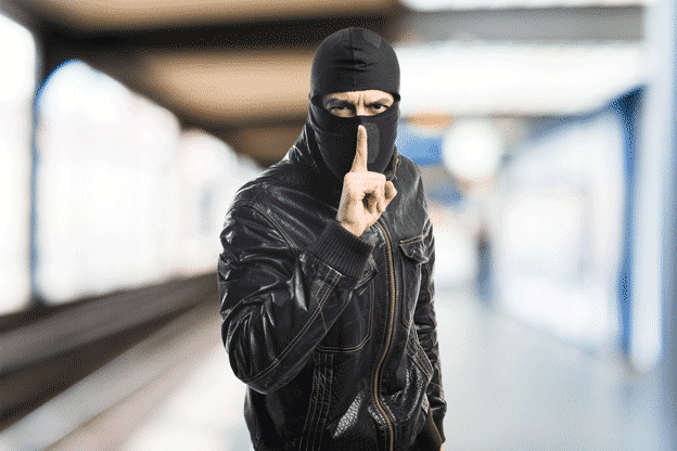 robber-making-silence-gesture