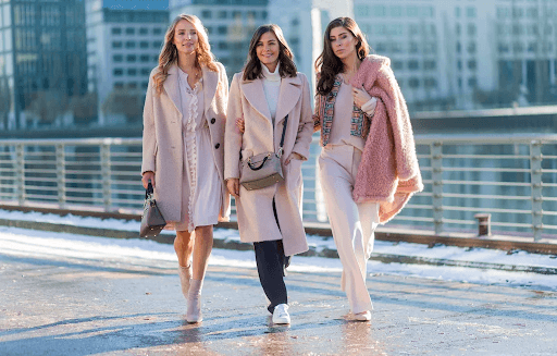 three women in pastel and frilly colored clothes and accessories