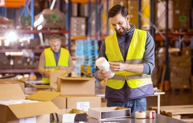 workers-sticking-labels-in-warehouse
